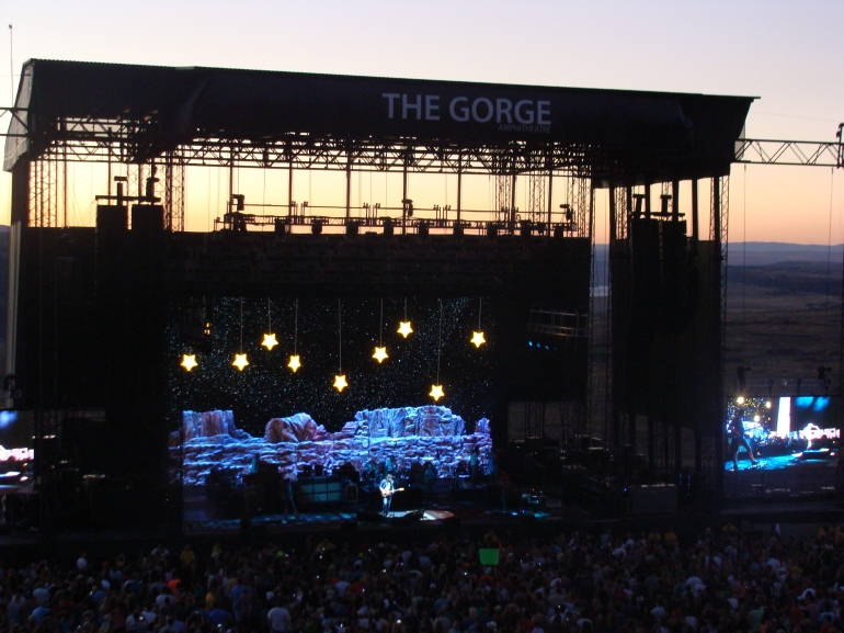 John Mayer at the Gorge with the  beautiful sunset in the background